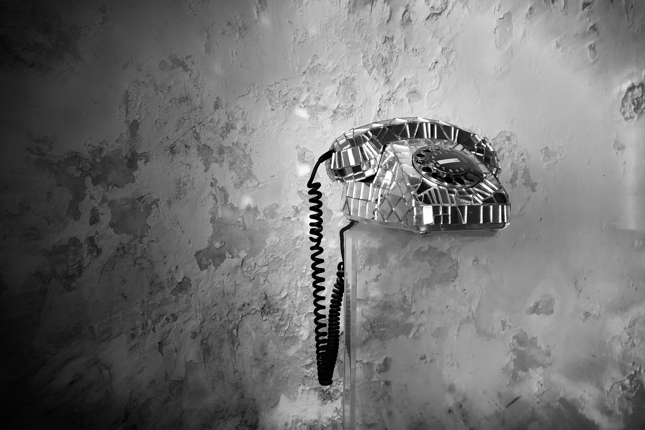 An old-fashioned, scary looking phone in a dilapidated room.