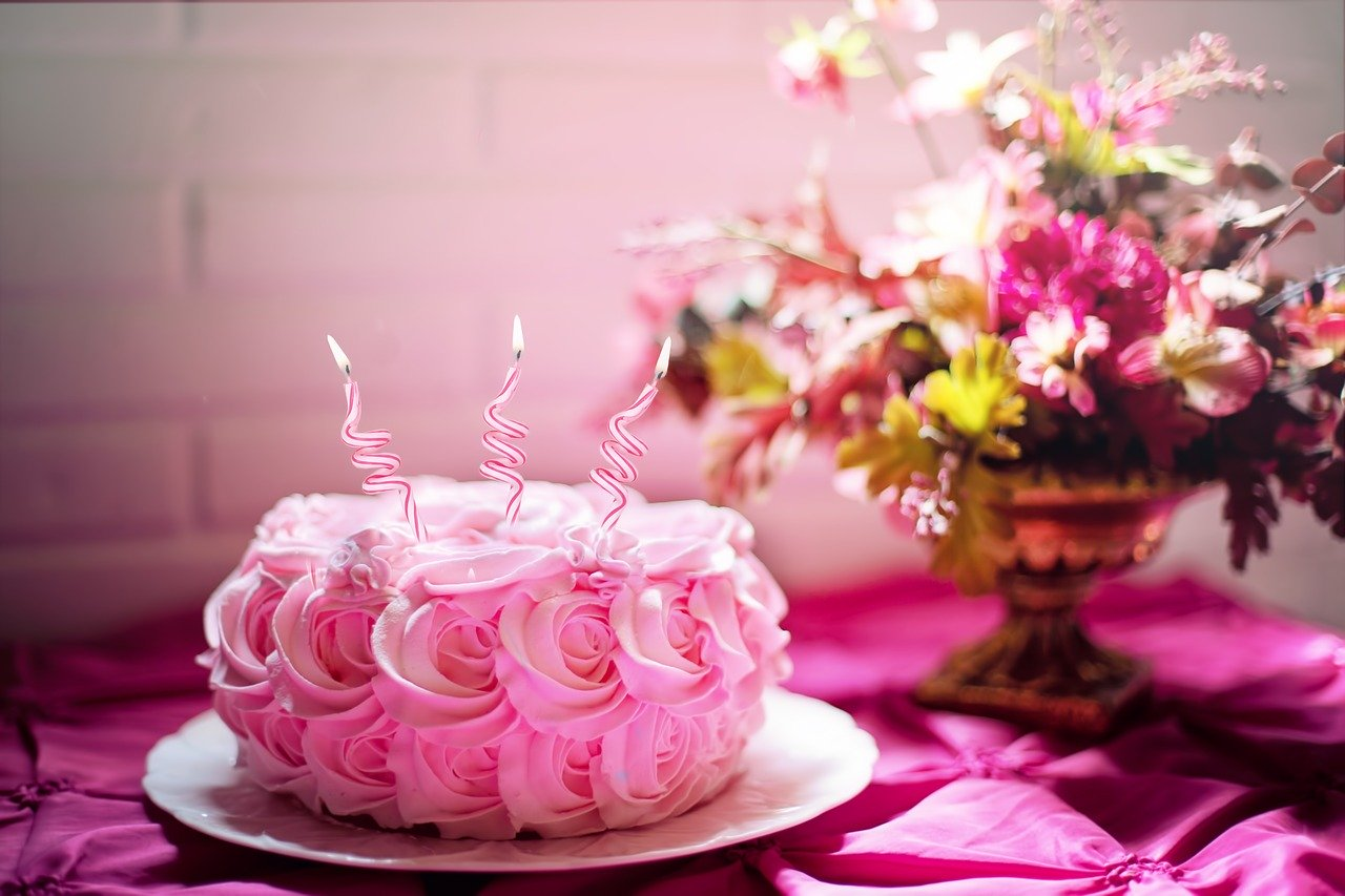 A photo of a cake with three candles in it