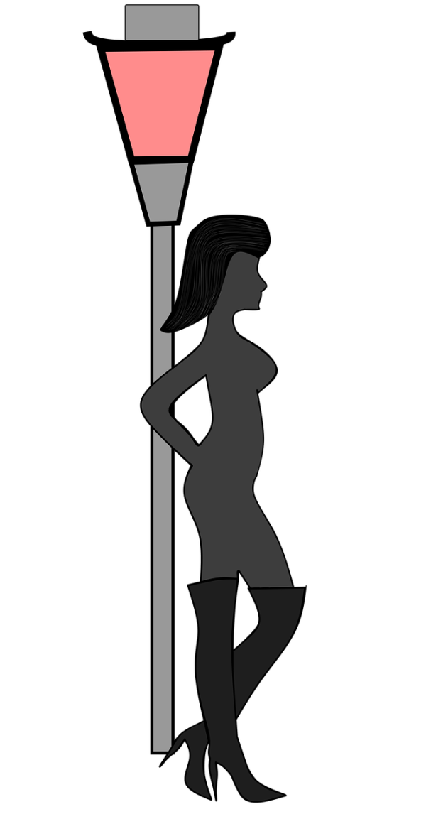 Sex worker against a streetlamp