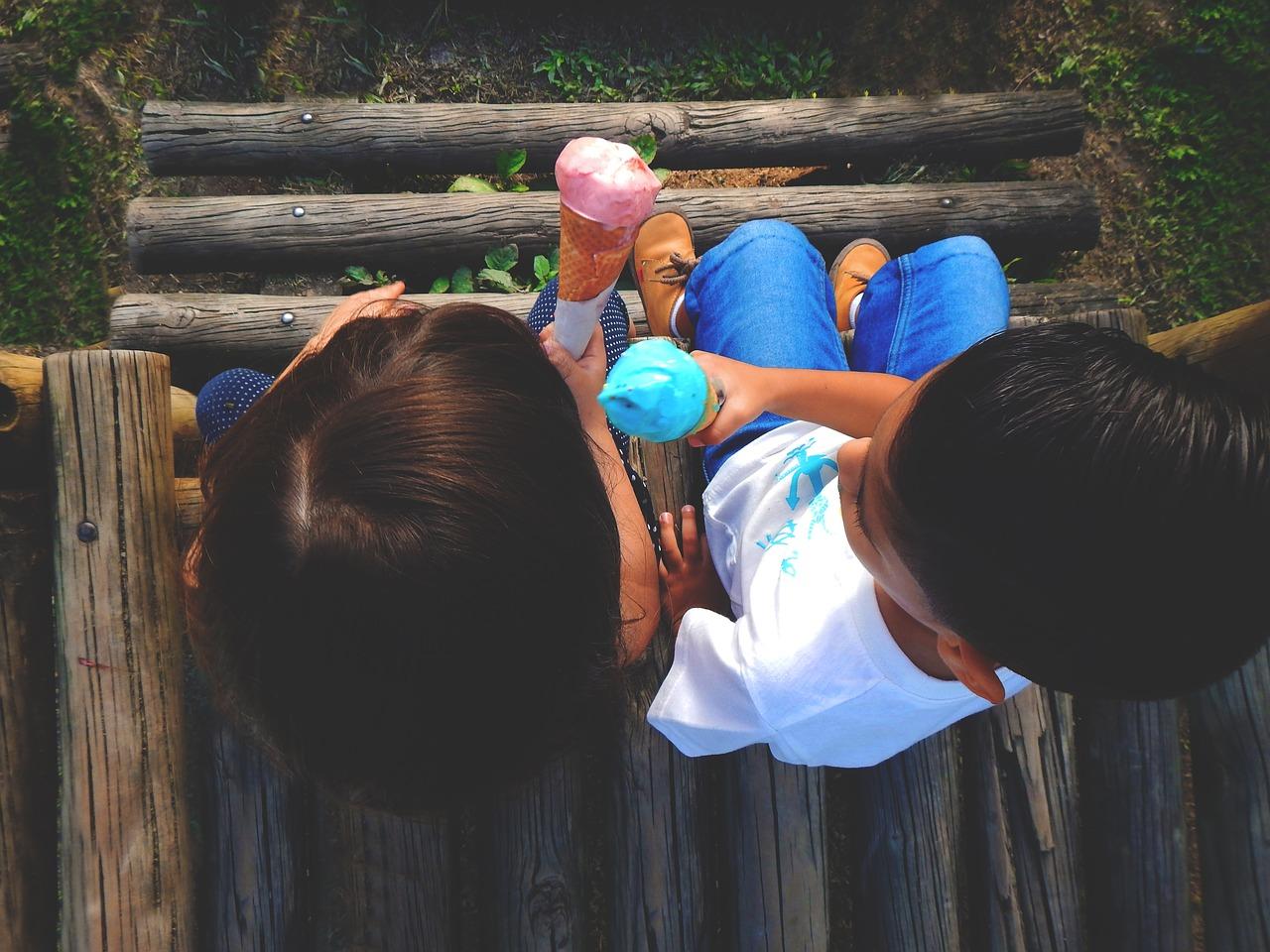 Kids sharing ice cream
